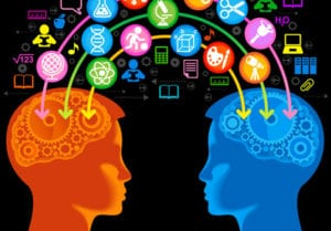 two heads with graphics of information passing back and forth